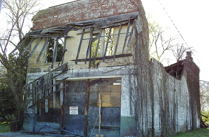 The remnants of of Bryant's Grocery and Meat Market. Photo via public domain.