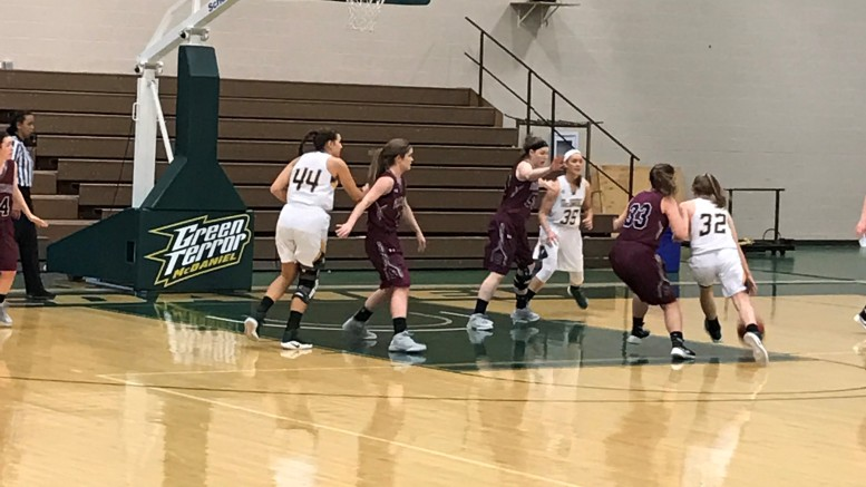 McDaniel's Liv Storer drives to the basketball in the Terror's 59-45 win over Swarthmore on Saturday, Feb. 4 at the Gill Center. Photo by Rebecca Olsen.
