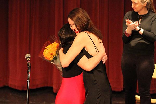 Jen Shillingburg embracing next year's director, Megan Smith. Photo by Jimmy Calderon.