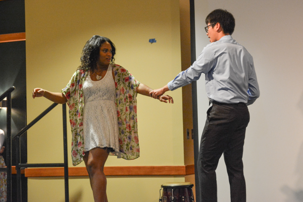 Navagaye Simpson and Phuc Truong displaying a cliché in Korean dramas in a skit. Photo by Kyle Parks.