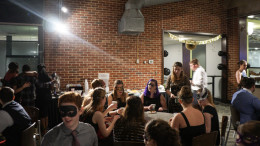 As masqueraders arrived, they were able to enjoy a snack and socialize. Photo by Kyle Parks.