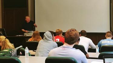 Professor Donald Lavin teaches a class. Photo by Brandon Vance.
