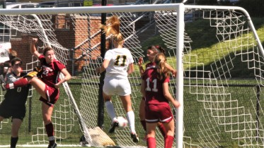 McDaniel's Marissa Funke finishes a corner from Abby Keen during the Green Terror's 4-3 win over Swarthmore on Sept. 23. Photo by Atticus Rice.