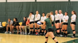 Captain Taylor Bauman readies her serve during McDaniel's 3-0 sweep of St. Mary's on Friday night.