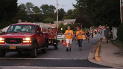 Parade participants marching off of Monroe Street. Photo by Tiffany Afoakwa.