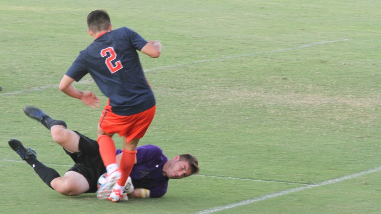 McDaniel's Nick Over makes a sliding save during their Sept. 27 loss to Gettysburg. Photo by Atticus Rice.