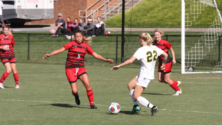 Kirsten Gibson battles for the ball during McDaniel's 1-0 shutout over Albright on Saturday. Photo by Atticus Rice.