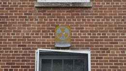 Fallout shelter signs on multiple campus buildings remind us of past and present nuclear threats. Photo by Kyle Parks.