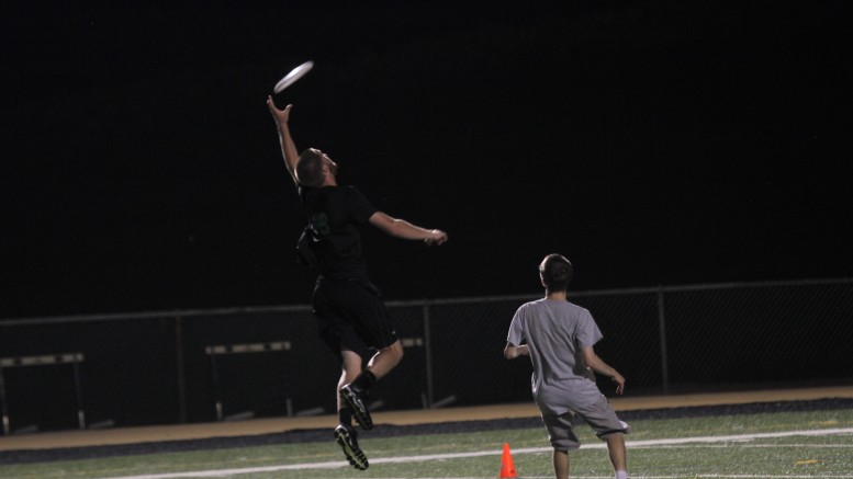 Team member Tate Myers jumps to secure the disc during a McDaniel Ultimate practice. Photo by Atticus Rice.