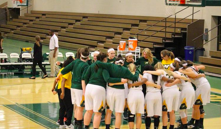 The women's basketball team during warmups.