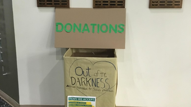 A donation box for the Women's Lacrosse fundraiser in Gill Gym. Photo by Hannah Maxwell.