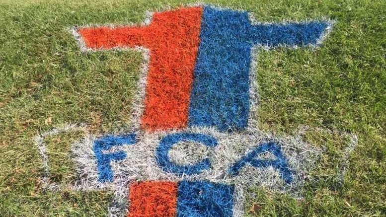 FCA's logo on the Hill at McDaniel's homecoming football game. Photo courtesy of Kyle Savick.