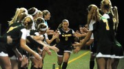 Senior and team captain Abby Keen is high-fived by her teammates ahead of an away match. Photo courtesy of Abby Keen.