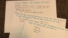Girls at the Boys & Girls Club's SMART Girls program write about what makes them happy. Photo by Katie Ogorzalek.