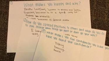 Girls at the Boys & Girls Club's SMART Girls program write about what makes them happy. Photo by Katie Ogorzalek.