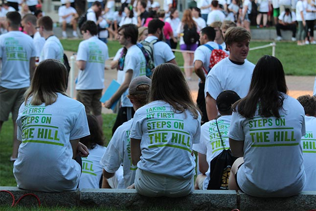Students from the class of 2022 and transfers to McDaniel College gather in Red Square ahead of the Convocation and Candlewalk as part of New Student Orientation on Friday, Aug. 24, 2018 in Westminster, Md. (Marya Topina / McDaniel College).