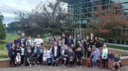 The sisters of Phi Alpha Mu and race participants pose after the Oct. 20 event. (Photo courtesy of Katie Ogorzalek).