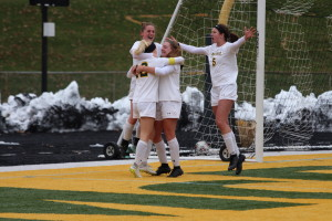 Members of the women's soccer team celebrate after the game-winning goal. (Gunnar Ward / McDaniel Free Press)