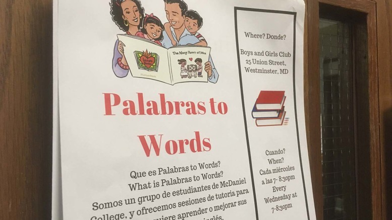A Palabras to Words flyer in Hill Hall. (Atticus Rice / McDaniel Fee Press).
