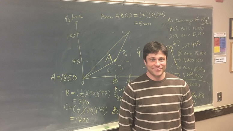 Dr. Nicholas Kahn stands in front of a chalkboard shortly after his Labor Economics lecture. (Ryan Hess / McDaniel Free Press).
