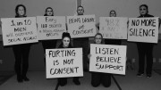 """Part of a Sexual Assault and Awareness month """"living display,"""" these individuals held signs depicting sexual assault statistics in order to raise awareness of the crime in April 2016. (Photo courtesy  airforcemedicine.af.mil)"""