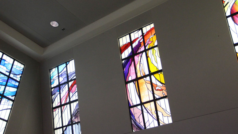 The traditional disciplines of the liberal arts--grammar, dialectic, rhetoric, arithmetic, geometry, astronomy, and music--are displayed through stained glass in Hoover Library. Music is second from Right. (Atticus Rice / McDaniel Free Press).