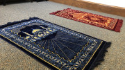 The interfaith prayer room opened to the campus on Tuesday, April 9 thanks to efforts from the Office of Diversity and Inclusion. The space is furnished with resources for students, including prayer rugs. (Atticus Rice / McDaniel Free Press).
