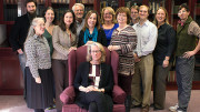 Pam Regis, center, is surrounded by English department faculty. (Photo courtesy of McDaniel website)