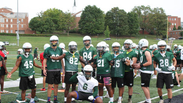 Habeeb Baba, number 6, poses with some team members during practice. (Sam Robertson / McDaniel Free Press).