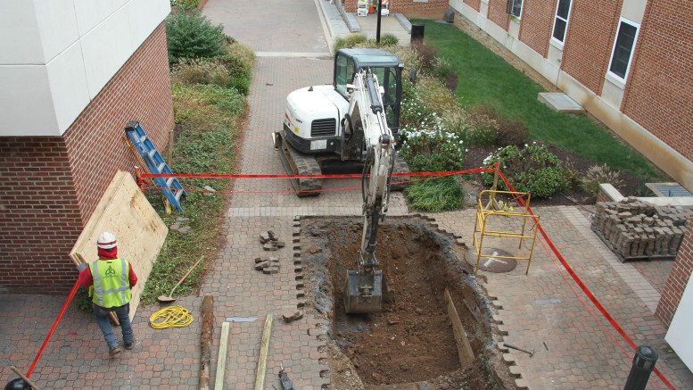 A construction crew performs repairs outside the entrance to Decker College Center on Thursday, Oct. 17. (Marya Kuratova / McDaniel Free Press).