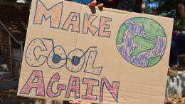 A student shows off a protest sign during the climate strike on Sept. 20. (Shaquille Tairellil / McDaniel Free Press).