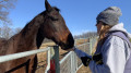 Melanie Biemiller feeds Star a mint. (Molly Sherman / McDaniel Free Press).