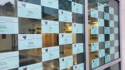 Students, staff, and alumni wrote notes explaining what they love about the Hill. These notes were then posted around campus, such as this window display in Klitzberg Pavilion. (Erin Pogue / McDaniel Free Press).