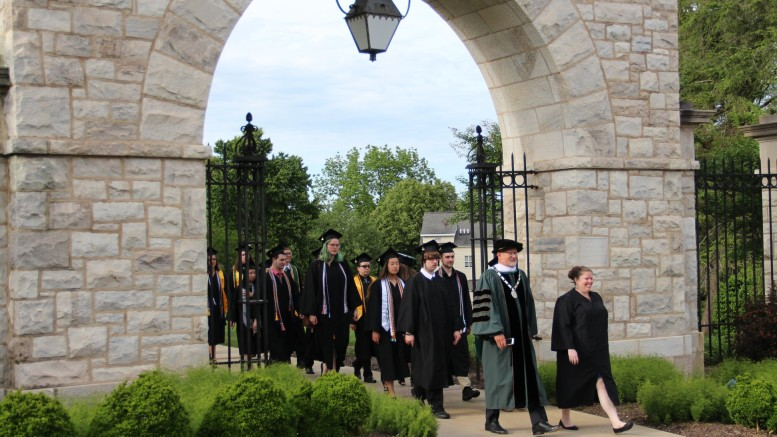 President Casey led the class of 2019 through the historic arch last year, following the candlelit ceremony. (Marya Kuratova / McDaniel Free Press).