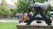 A master's student rings out in Red Square on May 25, 2019. Class of 2020 students will have the chance to participate in a virtual bell ringing ceremony. (Marya Kuratova / McDaniel Free Press).