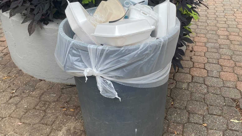 An overflowing trash can located outside Rouzer Hall (Shannon Musolf / McDaniel Free Press).