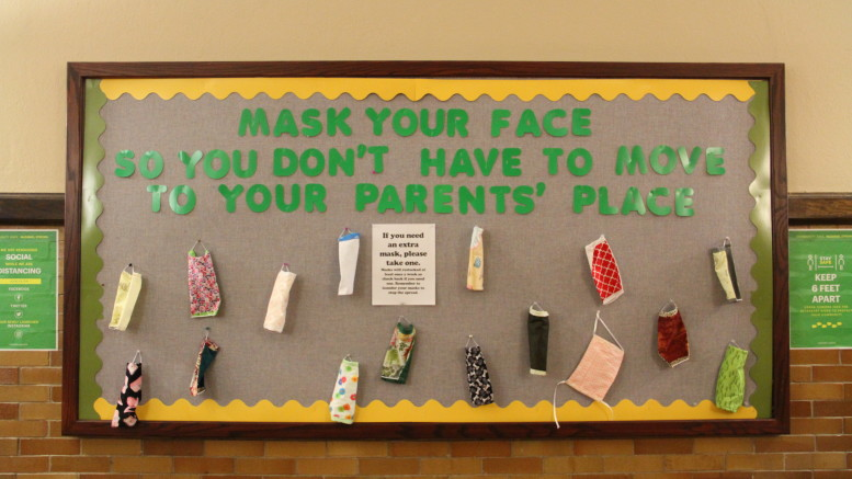 Tracy Fleming's board of masks is on the first floor of Lewis Recitation Hall (Ciara O'Brien / McDaniel Free Press).